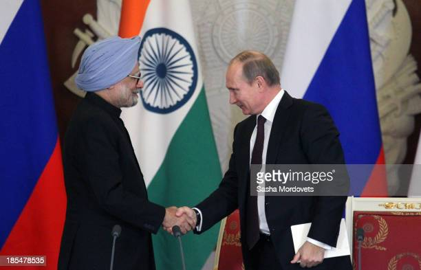 Russian President Vladimir Putin shakes hands with Indian Prime Minister Manmohan Singh during their bilateral meeting in the Kremlin on October 21,...