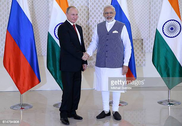 Russian President Vladimir Putin shakes hands with Indian Prime Minister Narendra Modi during their meeting at Taj Exotic Hotel on October 2016 in...