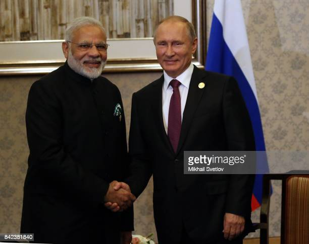Russian President Vladimir Putin shakes hands with Indian Prime Minister Narendra Modi during their meeting in Xiamen China September2017 Leaders of...