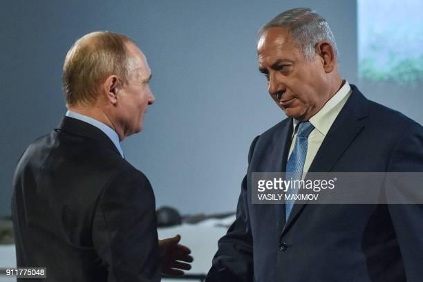 Russian President Vladimir Putin shakes hands with Israeli Prime Minister Benjamin Netanyahu during an event marking International Holocaust Victims...