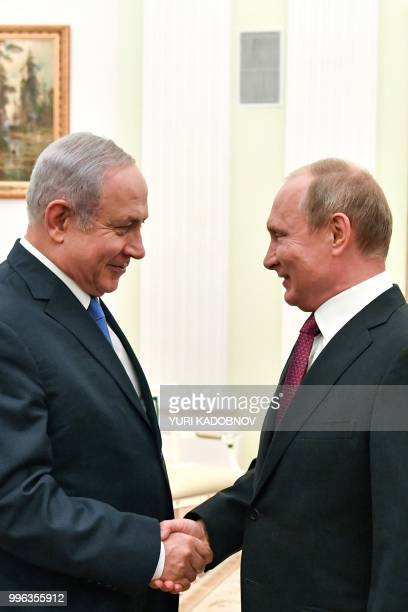 Russian President Vladimir Putin shakes hands with Israeli Prime Minister Benjamin Netanyahu during their meeting at the Kremlin in Moscow on July...