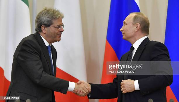 Russian President Vladimir Putin shakes hands with Italian Prime Minister Paolo Gentiloni after a joint press conference following their meeting at...