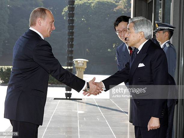 Russian President Vladimir Putin shakes hands with Japanese Emperor Akihito upon his arrival at the Imperial Palace on November 22 2005 in Tokyo...