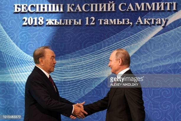 Russian President Vladimir Putin shakes hands with Kazakhtan's President Nursultan Nazarbayev during their meeting at the 5th Caspian Summit in Aktau...