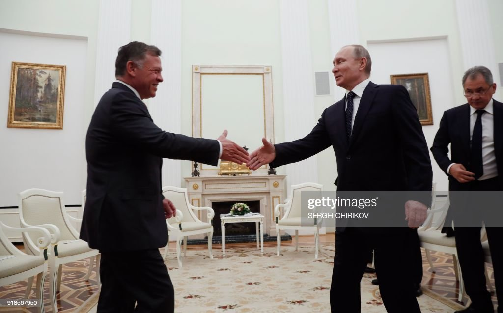 Russian President Vladimir Putin (2-R) shakes hands with King Abdullah II of Jordan (L) during their meeting at the Kremlin in Moscow, on February 15, 2018. /