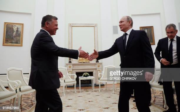 Russian President Vladimir Putin shakes hands with King Abdullah II of Jordan during their meeting at the Kremlin in Moscow on February 15 2018 / AFP...