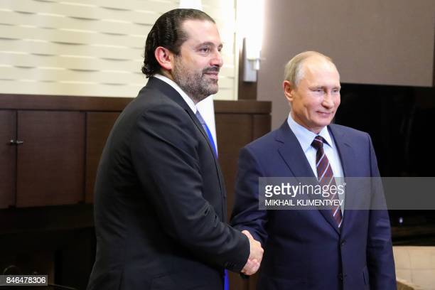 Russian President Vladimir Putin shakes hands with Lebanese Prime Minister Saad Hariri during a meeting in Sochi on September 13 2017 PHOTO / Sputnik...
