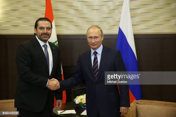 Russian President Vladimir Putin shakes hands with Lebanon's Prime Minister Saad Hariri during their talks in Sochi Russia September 2017 Putin is...