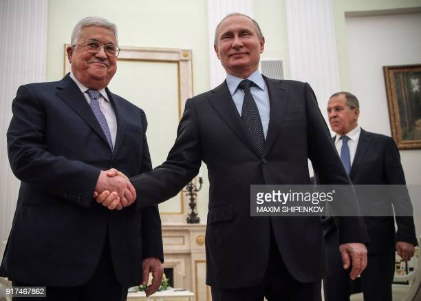 TOPSHOT Russian President Vladimir Putin shakes hands with Palestinian leader Mahmud Abbas during their meeting at the Kremlin in Moscow on February...