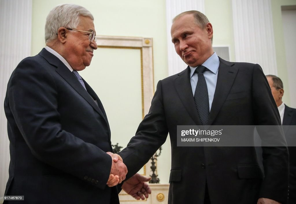 Russian President Vladimir Putin (R) shakes hands with Palestinian leader Mahmud Abbas during their meeting at the Kremlin in Moscow on February 12, 2018. The Palestinian leader is visiting Moscow in a bid to secure Putin's support after the US president outraged the Palestinians and their allies by recognising Jerusalem as Israel's capital. / AFP PHOTO / POOL / Maxim SHIPENKOV