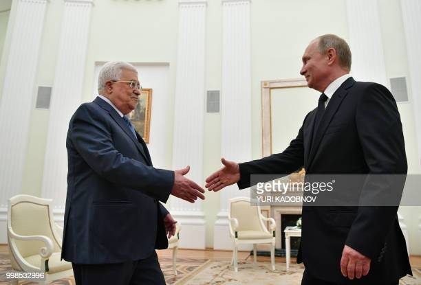 Russian President Vladimir Putin shakes hands with Palestinian President Mahmud Abbas during their meeting at the Kremlin in Moscow on July 14 2018