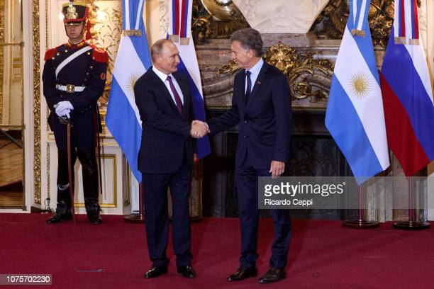 Russian President Vladimir Putin shakes hands with President of Argentina Mauricio Macri prior to a meeting between the presidents of Argentina and...