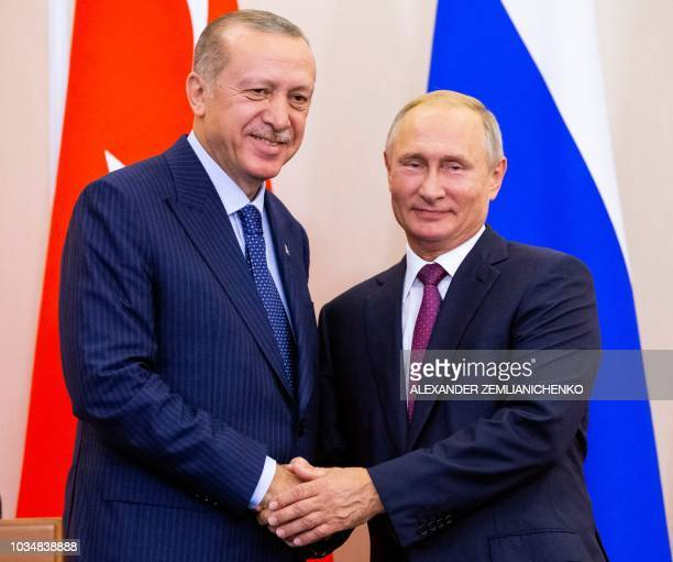 Russian President Vladimir Putin shakes hands with Turkish President Recep Tayyip Erdogan after their joint press conference following the talks in...
