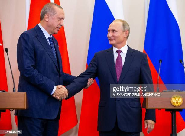TOPSHOT Russian President Vladimir Putin shakes hands with Turkish President Recep Tayyip Erdogan after their joint press conference following the...