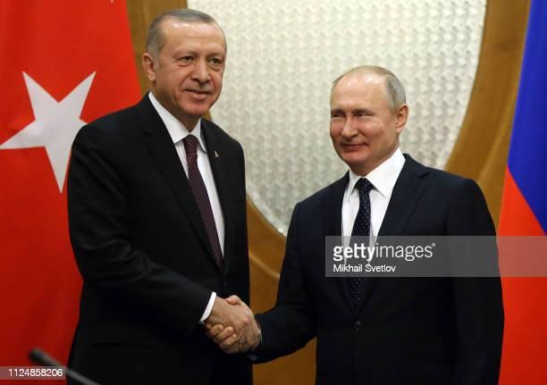 Russian President Vladimir Putin shakes hands with Turksih President Recep Tayyip Erdogan during their meeting on February 14, 2019 in Sochi, Russia....
