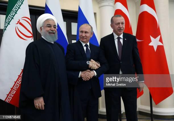 Russian President Vladimir Putin shakes hands with Turksih President Recep Tayyip Erdogan and Iranian President Hassan Rouhani during their meeting...