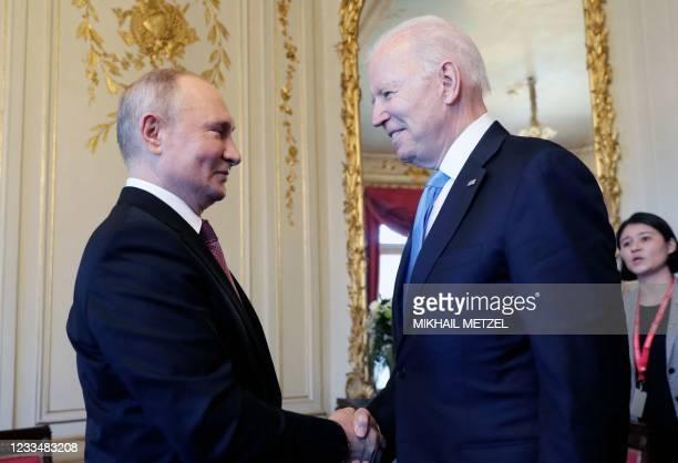 Russian President Vladimir Putin shakes hands with U.S President Joe Biden during their meeting at the 'Villa la Grange' in Geneva, Switzerland in...