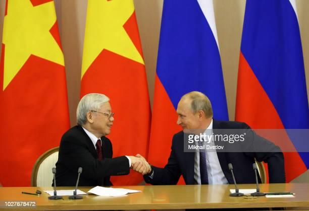 Russian President Vladimir Putin shakes hands with Vietnamese Communist Party General Secretary Nguyen Phu Trong during their meeting September 6,...