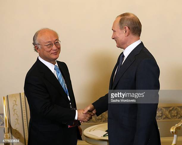 Russian President Vladimir Putin shakes hands with Yukiya Amano, director General of the International Atomic Energy Agency as leaders arrive for the...