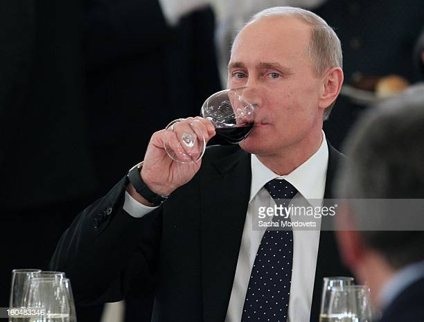 Russian President Vladimir Putin sips wine as he meets with veterans of the Battle of Stalingrad in the Grand Kremlin Palace February2013 in Moscow...