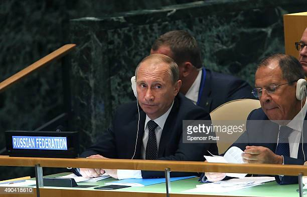 Russian President Vladimir Putin sits with the Russian Foreign Minister Sergey Lavrov at the United Nations General Assembly at UN headquarters on...