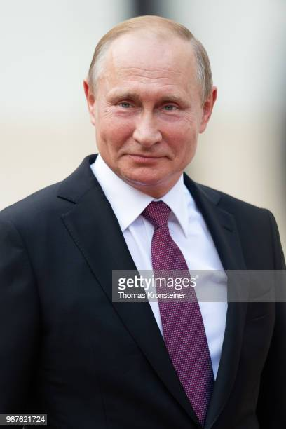Russian President Vladimir Putin smiles after reviewing a guard of honor upon Putin's arrival at Hofburg palace on June 5 2018 in Vienna Austria...
