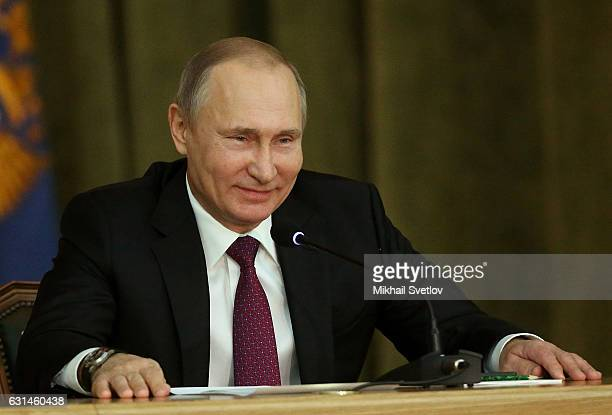 Russian President Vladimir Putin smiles as he visits the Prosecutor General's Office on January 2017 in Moscow Russia Vladimir Putin congratulated...