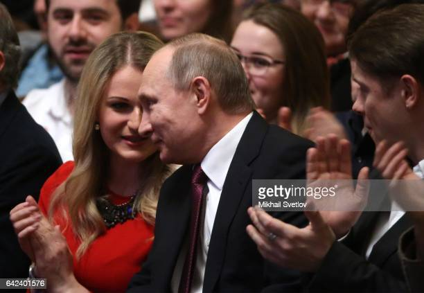 Russian President Vladimir Putin smiles as opera singer Dara Savinova looks on while visiting the premiere of theatre performance called 'Do not...