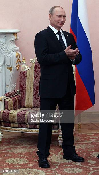 Russian President Vladimir Putin smiles during his meeting with French President Francois Hollande in Yerevan Armenia April2015 Putin and Hollande...
