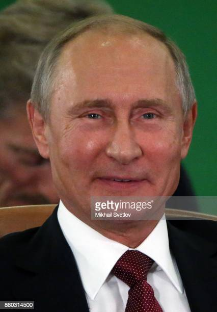 Russian President Vladimir Putin smiles during the CIS Summit October 12 2017 in Sochi Russia Leaders of exSoviet states have gathered in Sochi for...