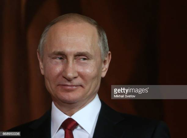 Russian President Vladimir Putin smiles during the Easter Service in the Christ The Saviour Cathedral in Moscow Russia early April 2017 Eastern...
