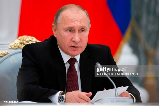 Russian President Vladimir Putin speaks a meeting to discuss preparation to mark the anniversary of the allied victory in the World War II in the...