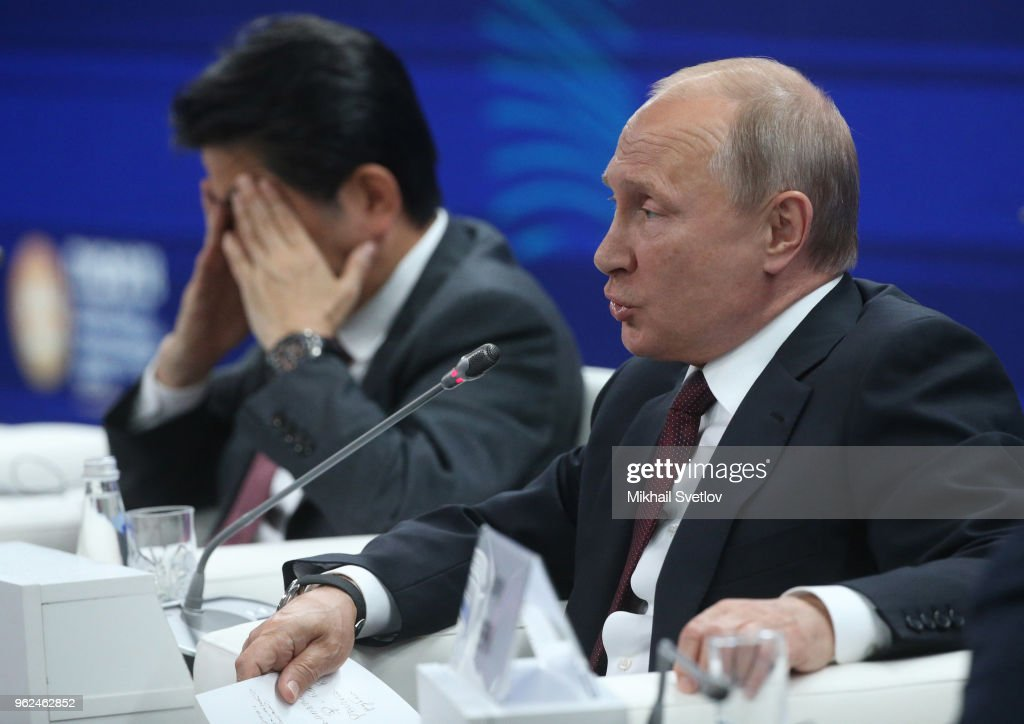 Russian President Vladimir Putin (R) speaks as Japanese Prime Minister Shinzo Abe (L) looks on during a meetiing with Russian and Japanese businessmen at the 2018 Saint Petersburg International Economic Forum in Saint Petersburg Russia, May,25, 2018. Vladimir Putin is having a three-days to Saint Petersburg and planning to take part in the Saint Petersburg Economic Fourm SPIEF 2018, to meet French President Emmanuel Macron and Japanese Prime Minister Shinzo Abe.