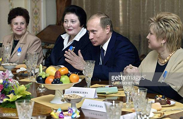 Russian President Vladimir Putin speaks as Margarita Miroyedova Valentina Zaikina and Galina Kiselyova listen during the meeting of Vladimir Putin...