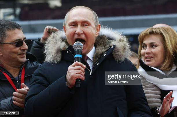 Russian President Vladimir Putin speaks during a campaign concert as supporters celebrities and dignitaries look on at Luzhniki Stadium on March 3...