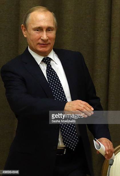 Russian President Vladimir Putin speaks during a meeting with military commanders and other officials of Russian Defence Ministry in Bocharov Ruchey...