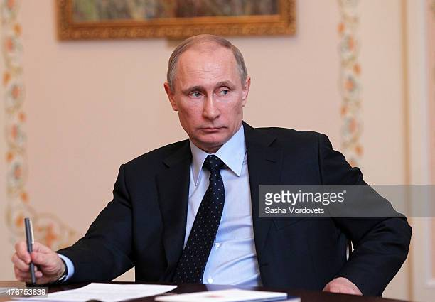 Russian President Vladimir Putin speaks during a meeting with ministers from The Summit of Eurasian Economic Cooperation Council at Novo Ogaryovo...