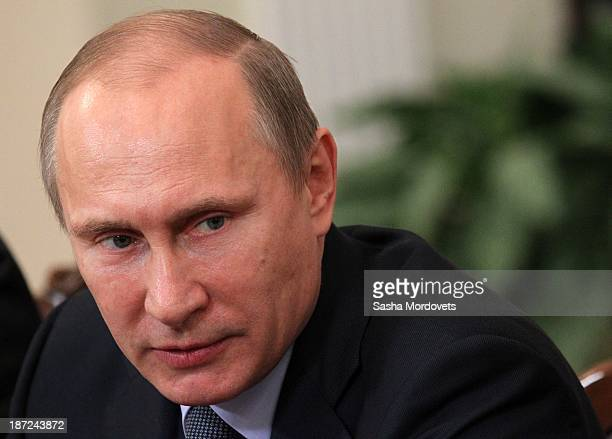 Russian President Vladimir Putin speaks during a meeting with chairmans of university's constitutional laws chairs November 7 2013 in Novo Ograyovo...
