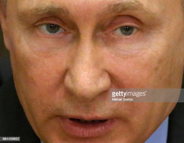 Russian President Vladimir Putin speaks during a meeting with senior defense officials on drawing up a new state armament program for 20182025 on May...