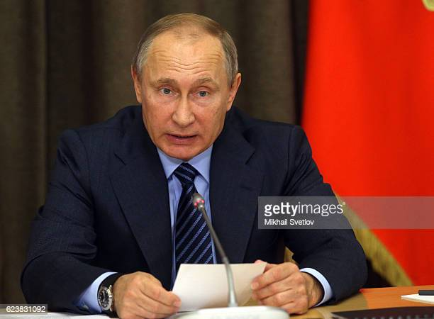 Russian President Vladimir Putin speaks during a meeting with top highranked officers of the Russian Defence Ministry and other top military...