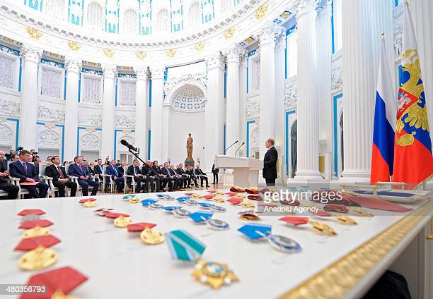 Russian President Vladimir Putin speaks during a state award ceremony for the participants of the Olympic and Paralympics Games in Sochi in the...