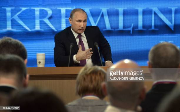 Russian President Vladimir Putin speaks during his annual press conference in Moscow on December 18 2014 Putin crushed Chechnya's rebellion pushed...