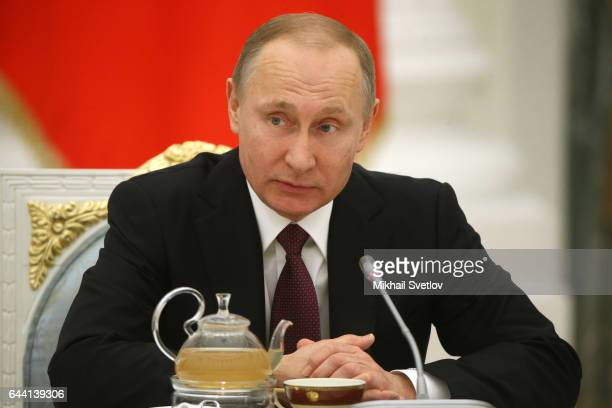 Russian President Vladimir Putin speaks during his meeting with naval officers and jet and bomber pilots who took part in the military operation in...
