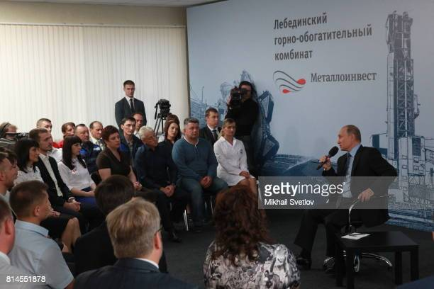 Russian President Vladimir Putin speaks during his meeting with workers while visiting the Lebeninsky GOK the plant for mining and beneficiation of...