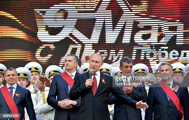 Russian President Vladimir Putin speaks during his visit to the Crimean port of Sevastopol on May 9 2014 Putin's visit to Crimea which was annexed by...