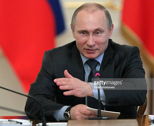 Russian President Vladimir Putin speaks on the economy during a meeting of the Supervisory Board of the Agency for Strategic Initiatives at his...