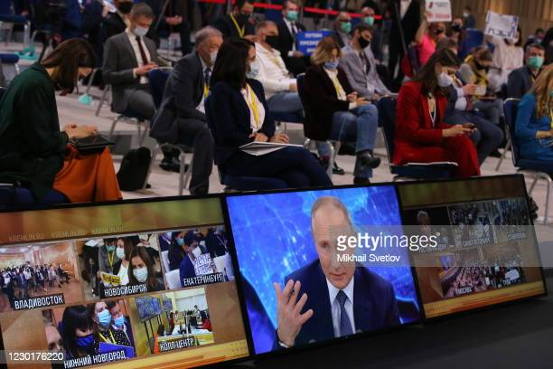 Russian President Vladimir Putin speaks on the screen during his annual press conference on December 17, 2020 in Moscow, Russia. This year about 250...