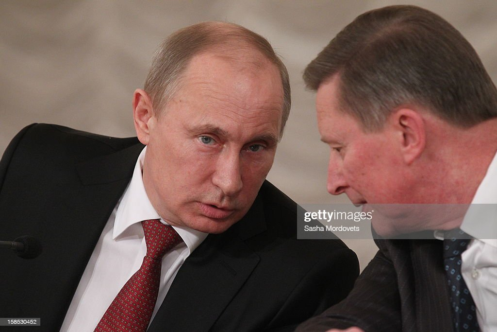 Russian President Vladimir Putin speaks to Chief of Presidential Administration Sergey Ivanov (R) during the all-Russia congress of judges on December 18, 2012in Moscow, Russia. In his speech Putin he reminded the participants that courts are very important state institutions and cautioned judges against mistakes, bureaucratic self-conceit and bribery.