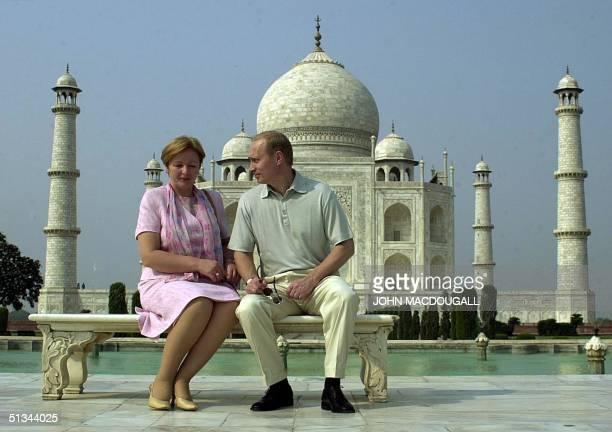 Russian President Vladimir Putin speaks to his wife Lyudmila as they pose in front of the Taj Mahal 04 October 2000 Putin is on a threeday visit to...