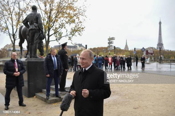 Russian President Vladimir Putin speaks to journalists after the flowerlaying ceremony marking the centenary of the Armistice Day at the Monument to...